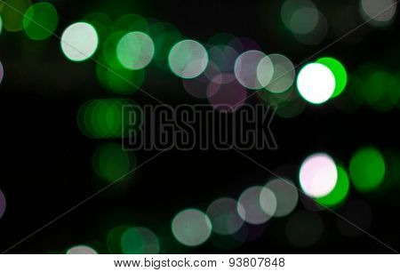Bokeh background pattern of colorful light, glittering at night.