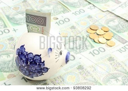 Piggy Bank, Money And Coins On Heap Of Banknotes