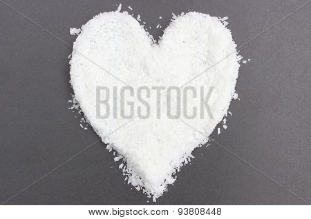 Heart Of Desiccated Coconut Isolated On Black Background