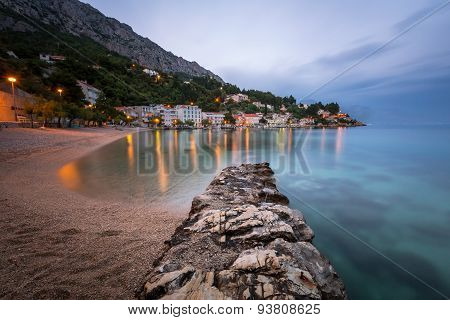 Beautiful Adriatic Beach And Mimice Village On Omis Riviera In The Evening, Dalmatia, Croatia