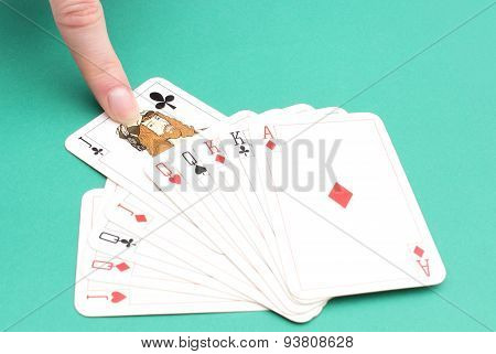 Finger Of Woman Pulling Game Card From Stack Of Cards