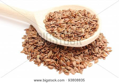 Wooden Spoon With Heap Of Linseed On White Background
