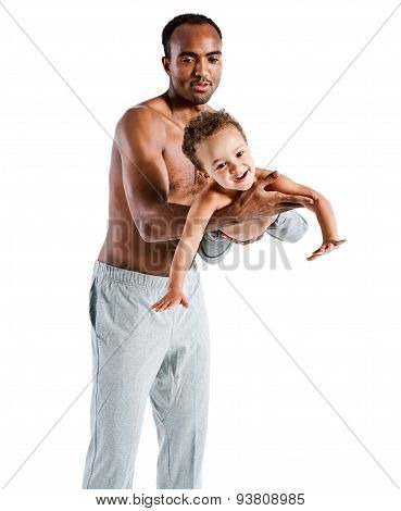 Careful Father Playing With His Child, Family And Father's Day Concept