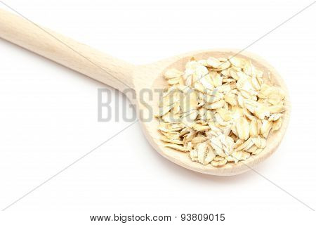 Heap Of Oatmeal With Wooden Spoon On White Background