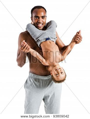 Happy Joyful Father Having Fun With His Kid, Family And Father's Day Concept