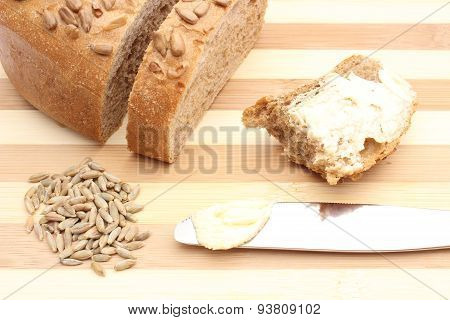 Rye Grain, Butter On Knife And Slice Of Bread