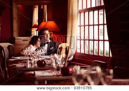 Bride And Groom At Restaurant, In A Warm Atmosphere