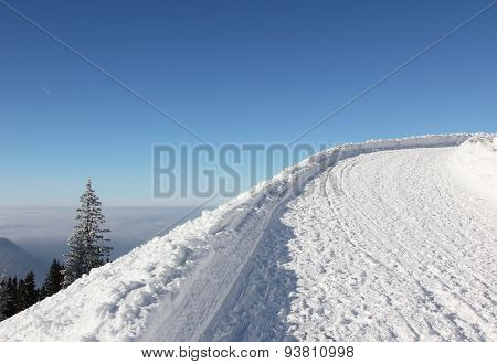 Toboggan Run In Wintry German Alps, Blue Sky