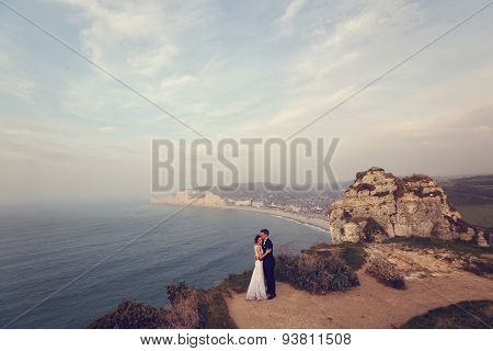 Bride And Groom On Cliff Of Normandy