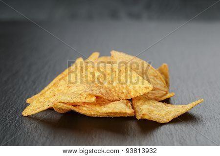 tortilla nachos on dark slate board