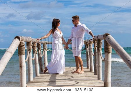 Bride And Groom Together On A Wharf