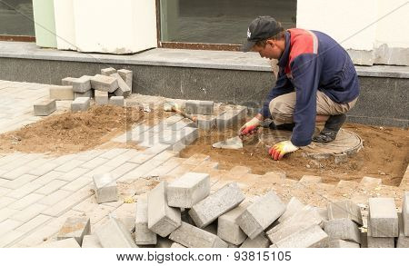 Builder Smoothing Sand For Pedestrian Walkway