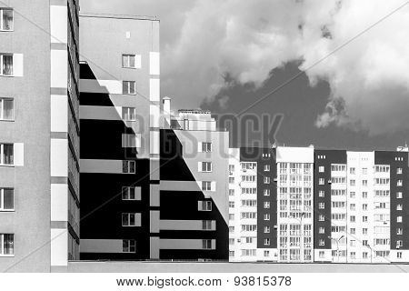 Monochrome Modern Housing Blocks And Brooding Sky