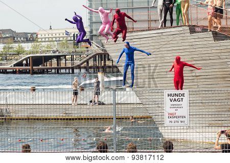 Costumed Adults Jump In Pool