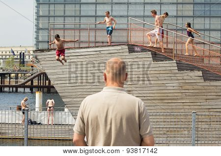 Children Jumping In City Pool