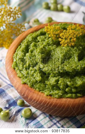 Puree Of Fresh Green Peas Macro In A Wooden Bowl. Vertical