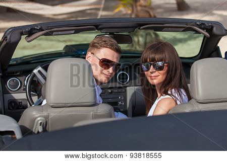 Beach Couple In Convertible Car On The Beach