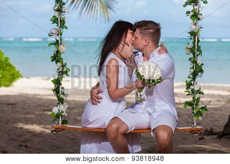 Young Loving Couple On The Swing
