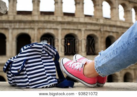 Striped bag and pink sneakers