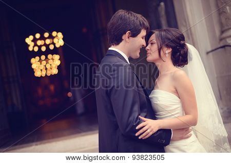 Bride And Groom In Front Of The Curch