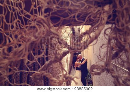 Bride And Groom Photographed Through Ropes