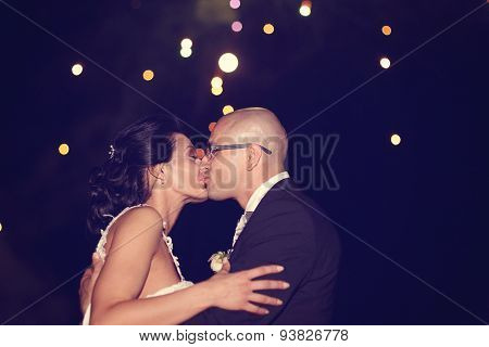 Bride And Groom Surrounded By Fire Crackers