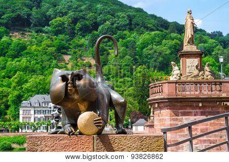 HEIDELBERG, GERMANY - MAY 28, 2015: Bronze sculpture of a monkey on the old bridge in Heidelberg.