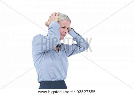 Worried businesswoman holding her head on white background