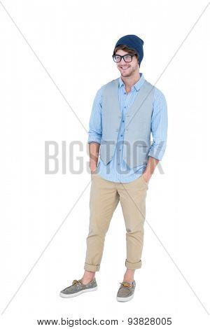 Geeky hipster with hands in pocket on white background