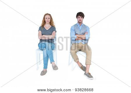 Angry couple not talking after argument on white background