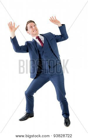 A surprised businessman holding something on white background