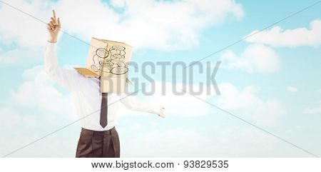 Anonymous businessman with arms out against blue sky