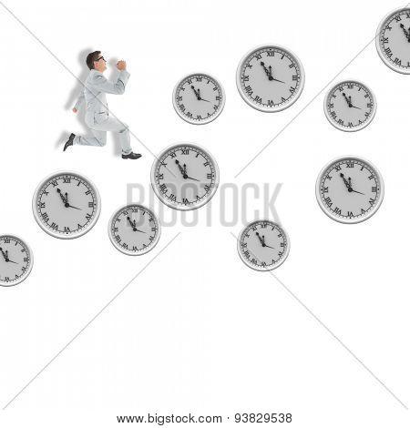 Geeky happy businessman running mid air against clocks