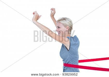 Happy business team cutting red ribbon with a blank background
