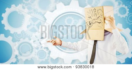 Anonymous businessman with his smartphone against white wheels and cogs on blue