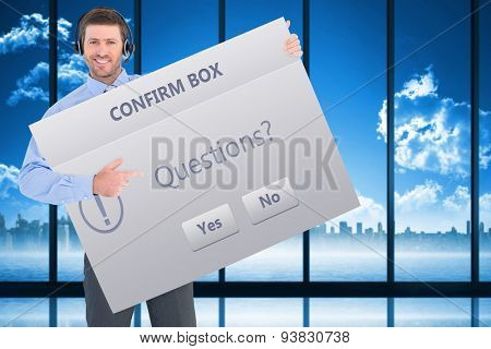 Businessman showing card wearing headset against confirm box