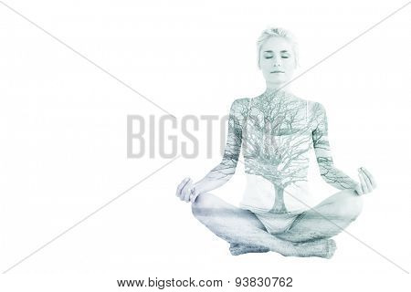 Toned young woman sitting in lotus pose with eyes closed against tree in showy field