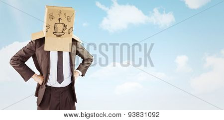 Anonymous businessman with hands on hips against blue sky