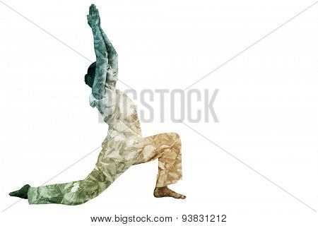 Content brunette in white doing tai chi against detail shot of dry leaves
