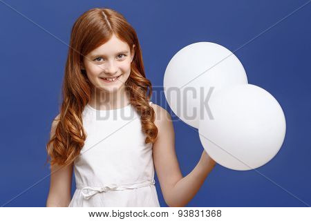 Pretty girl holding balloons