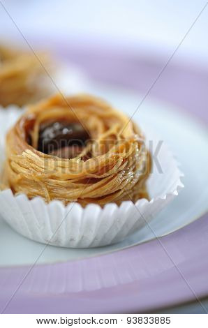 Bird's nest - a mediterranean sweet presented in a paper cups. Tight closeup shot.
