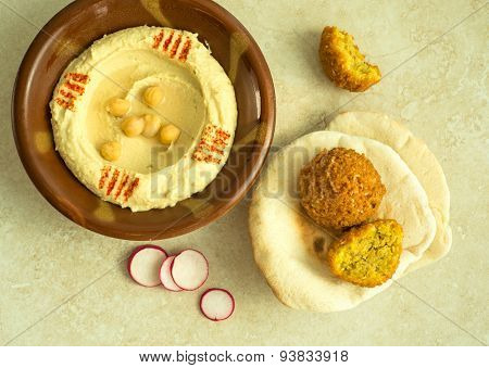 Hummus, with fried falafel and pita bread - a popular middle-eastern food.