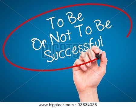 Man Hand writing To Be Or Not To Be Successful with black marker on visual screen.