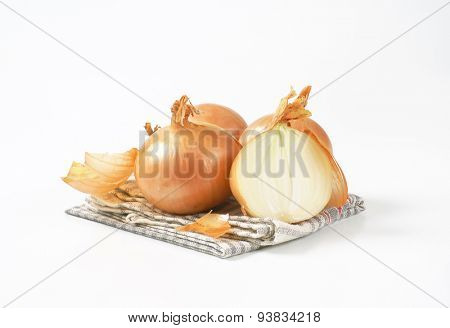 raw onions on grey checkered dishtowel