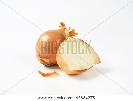 one and half raw onion on white background