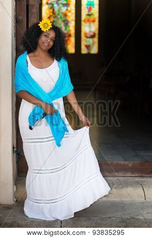 Beautiful young black cuban woman wearing a traditional white dress