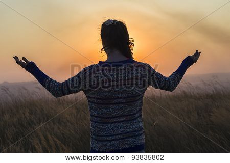 Girl Arms Raised Sunset