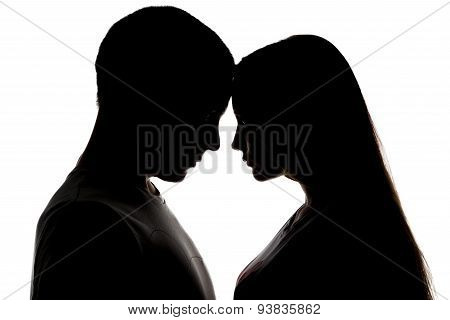 Silhouette of two loving teenagers
