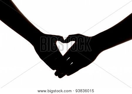 Silhouette of two hands showing heart