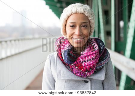 Portrait of happy woman in warm clothing standing outdoors